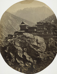 Village on top of a rocky cliff in the Himalayas.